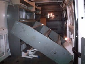 Old Steel Shelves Ripped Out Of Cargo Van Interior